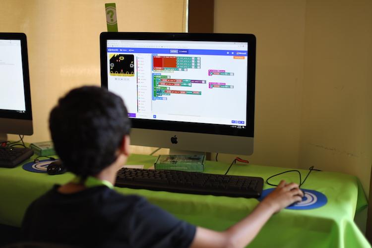 kid at computer programming