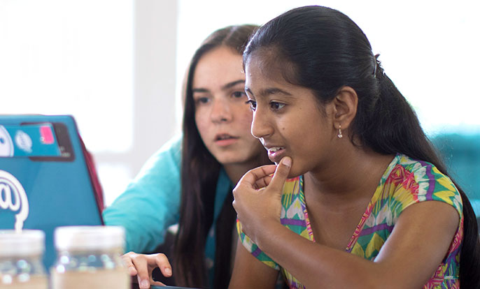 two girls at computer coding