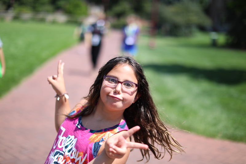 girl doing peace signs and goofy face