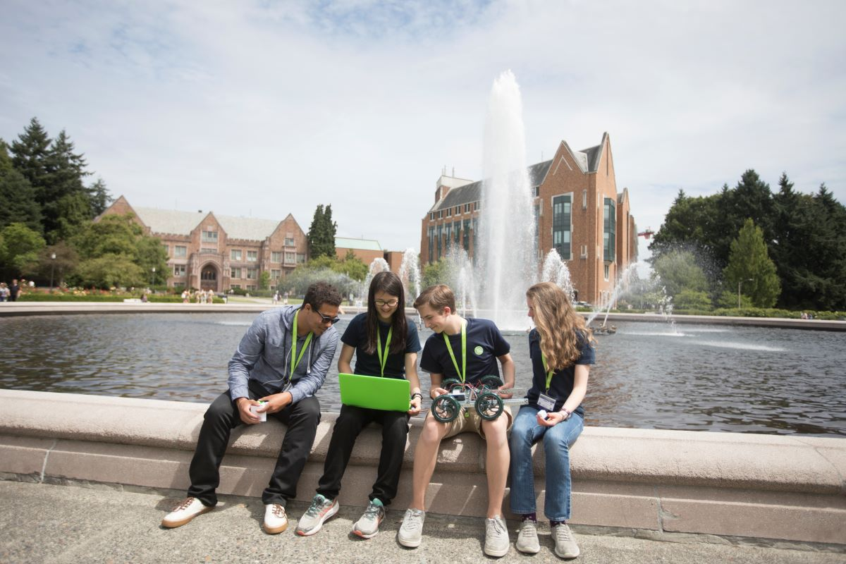 Group of teens sitting around a fountain