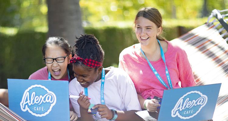 girls laughing at laptop computer
