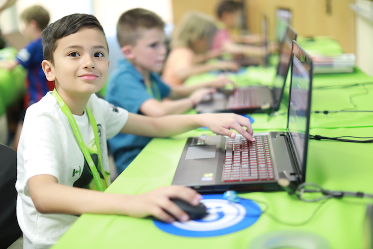 boy learning java at laptop