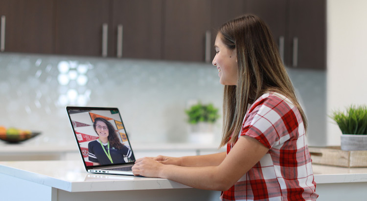 girl at laptop with online tutor