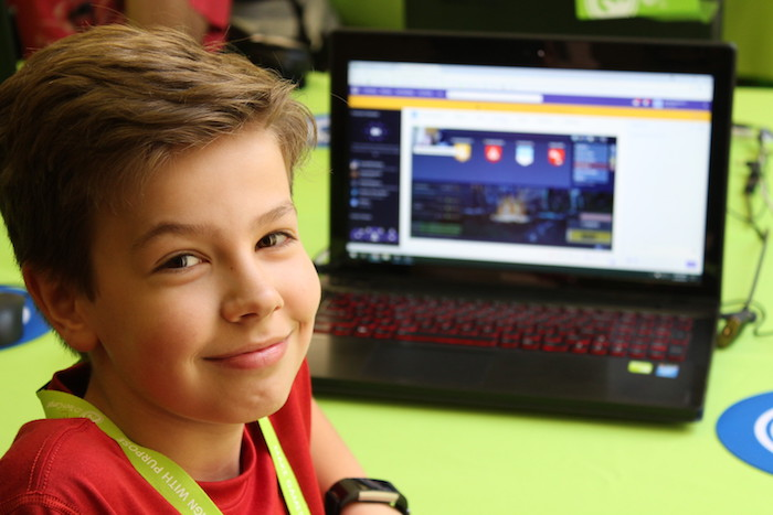 boy smiling at computer camp