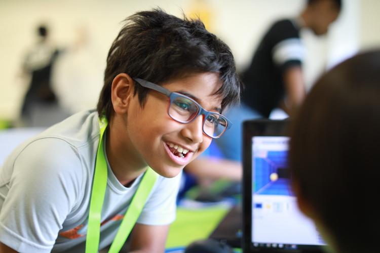 summer camper in glasses smiling