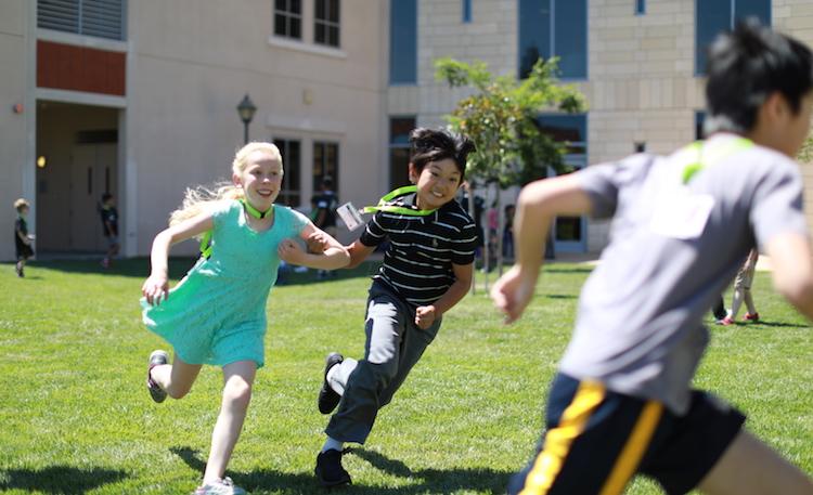 girl and boy running at summer camp