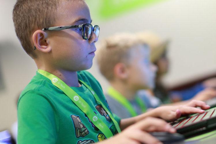 boy at computer coding