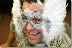 man with silver and feather mask