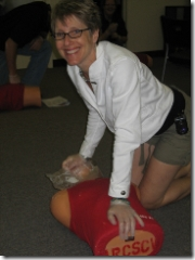 woman working on cpr dummy